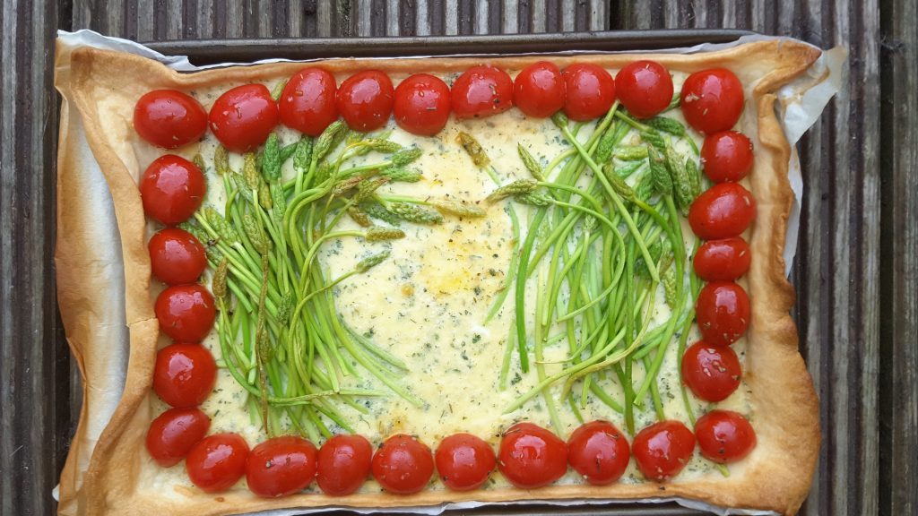 Wild asparagus tart with tomatoes